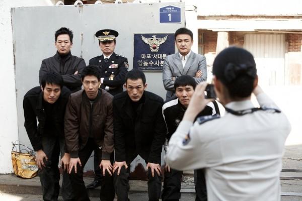 경찰의 과잉실적 경쟁 등을 다룬 코메디영화 '체포왕'의 한 장면
