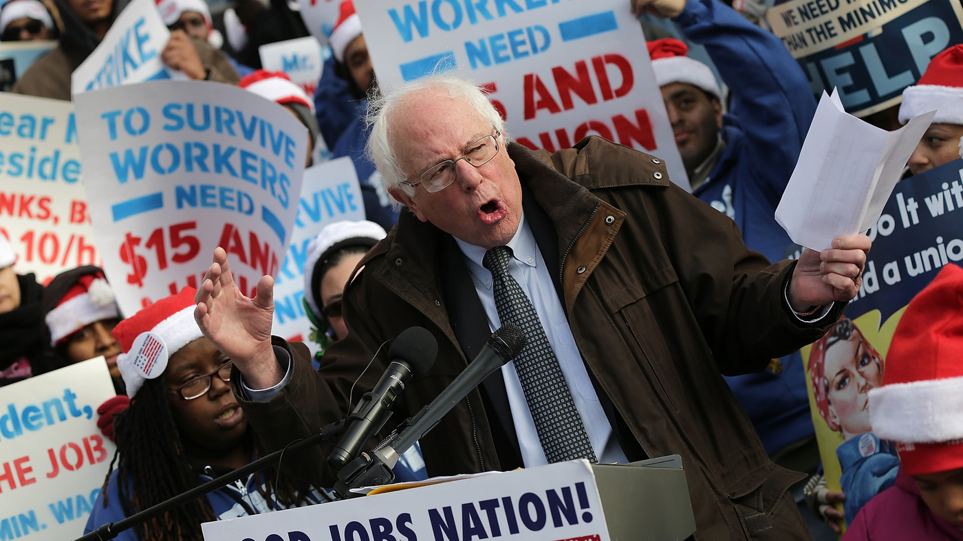 Sen. Bernie Sanders, I-Vt., speaks at a rally demanding presidential action to raise the minimum wage to $15 an hour. Sanders will run to Hillary Clinton's left, trying to elevate economic issues.